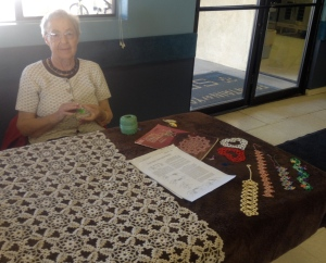 Marlene, the Tatting Lady.  The lace tablecloth in front of her is an example of her beautiful work.