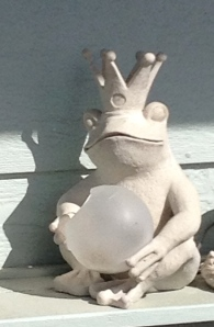 A frog-prince in someone's front yard