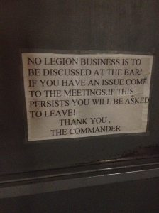 The sign on the front door.